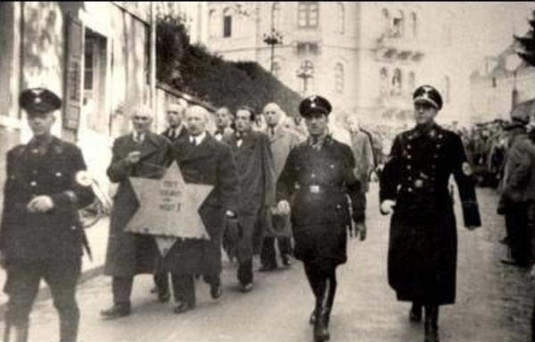 Jews forced to march with star Kristallnacht 01