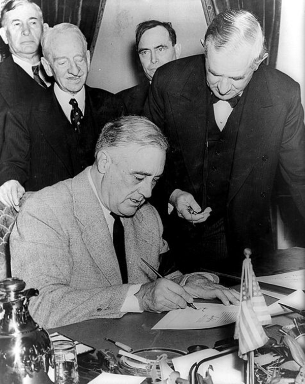 Wikimedia Commons   Franklin Roosevelt signing declaration of war against Germany